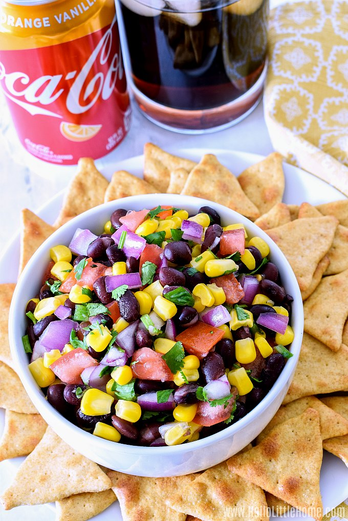 A bowl of Black Bean and Corn Salsa on a marble counter.