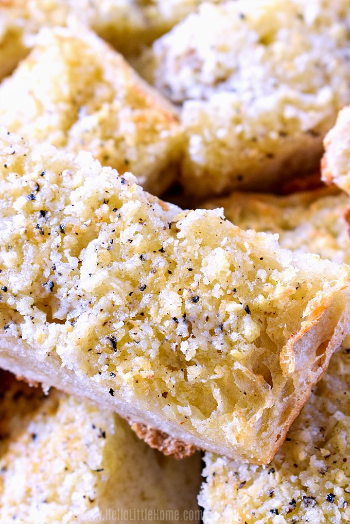 Closeup of a plate of garlic bread slices.