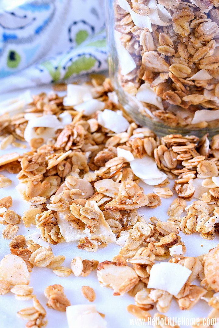A finished granola recipe on a marble counter and in a mason jar.