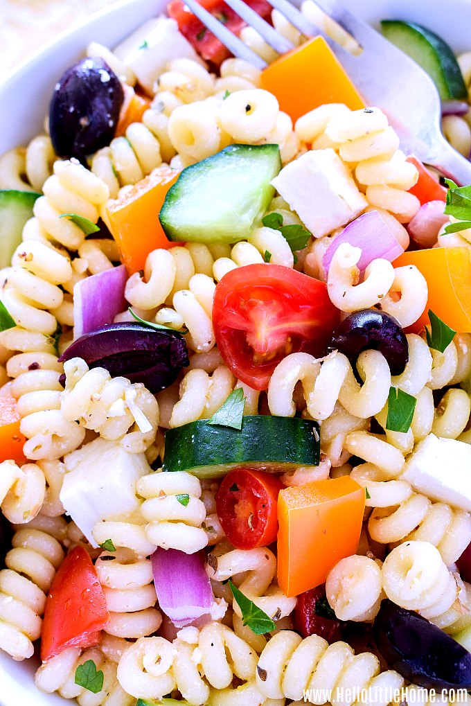 Close up of a Greek Pasta Salad with feta and veggies.
