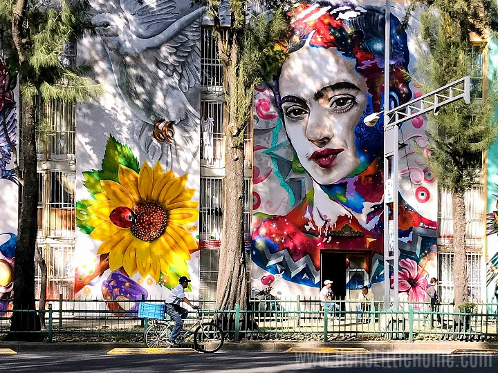 Colorful street art on a quiet street in Mexico City.