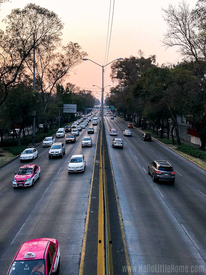 CDMX traffic on a highway at sunset.