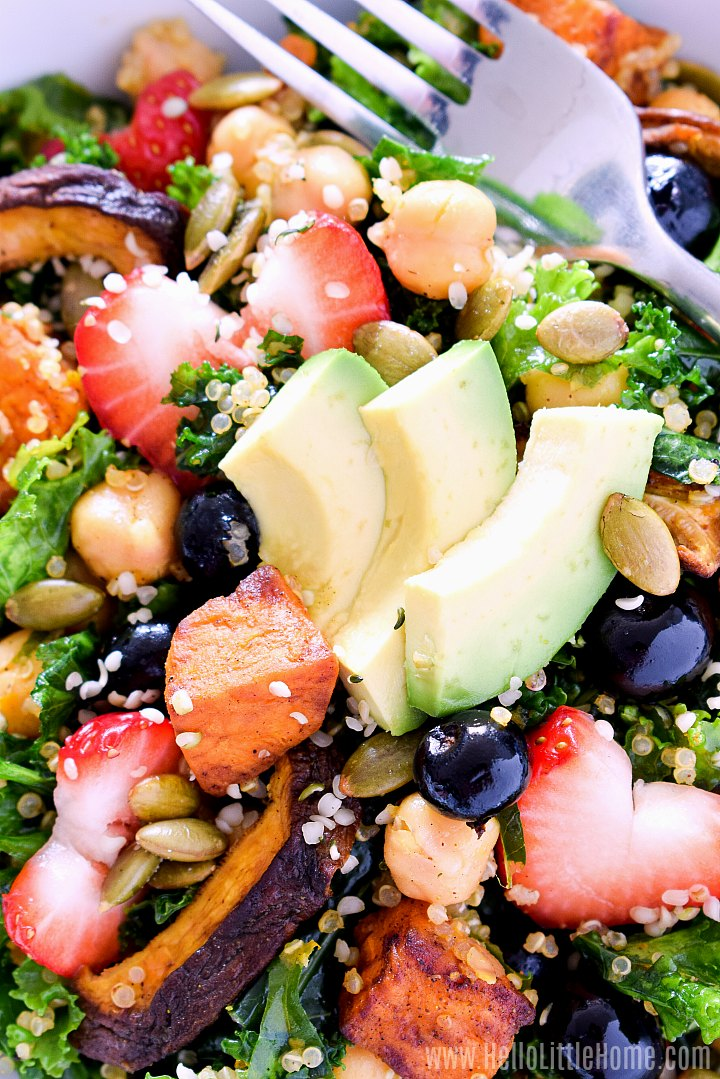 Closeup of a kale quinoa Superfood Salad topped with avocaodo.