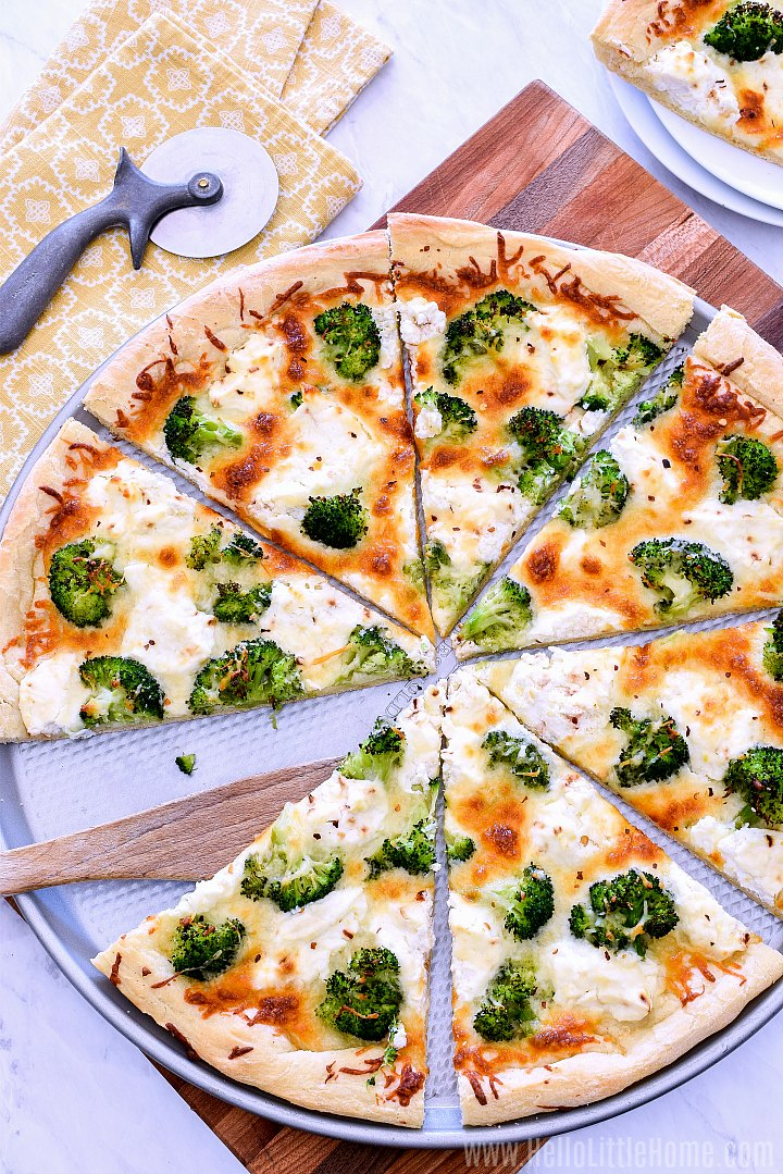 A Ricotta Pizza topped with broccoli.