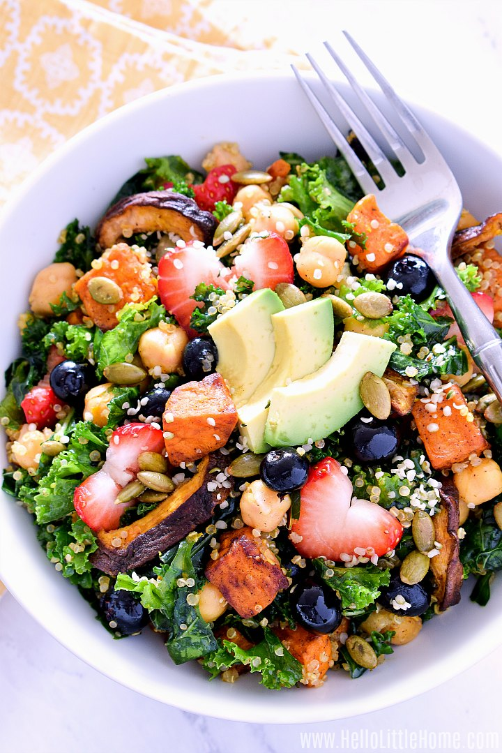 Superfood Salad recipe served in a bowl with a fork and napkin.