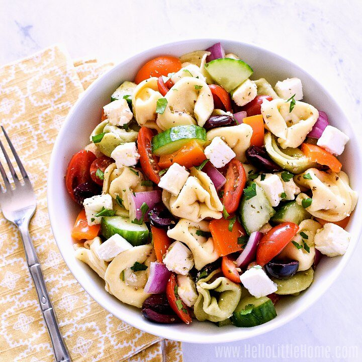 Tortellini Salad in a white bowl.