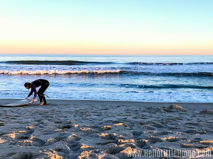 A surfer on the beach in Rockaway Beach.