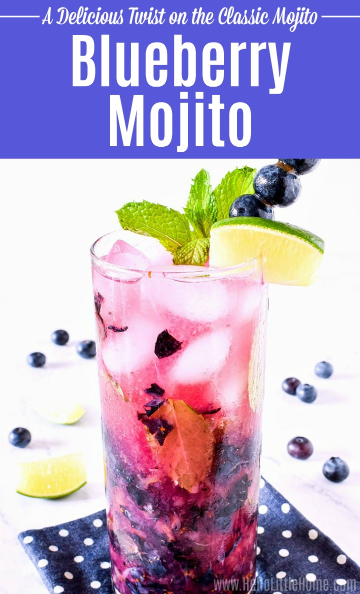 A Blueberry Mojito on a blue polka dot cocktail napkin.