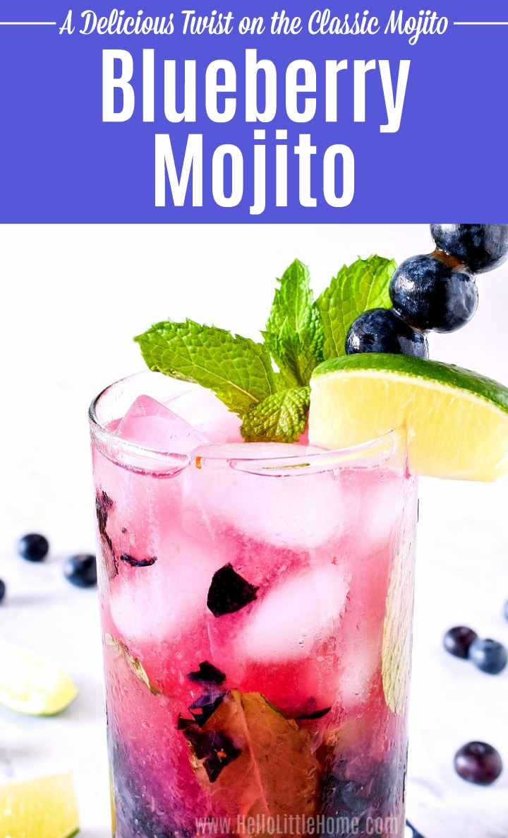 Closeup of a Blueberry Mojito on a white marble counter.