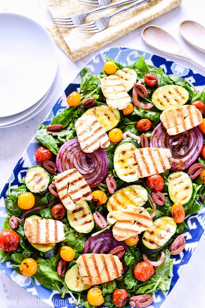 A Grilled Halloumi Salad served on a large platter.