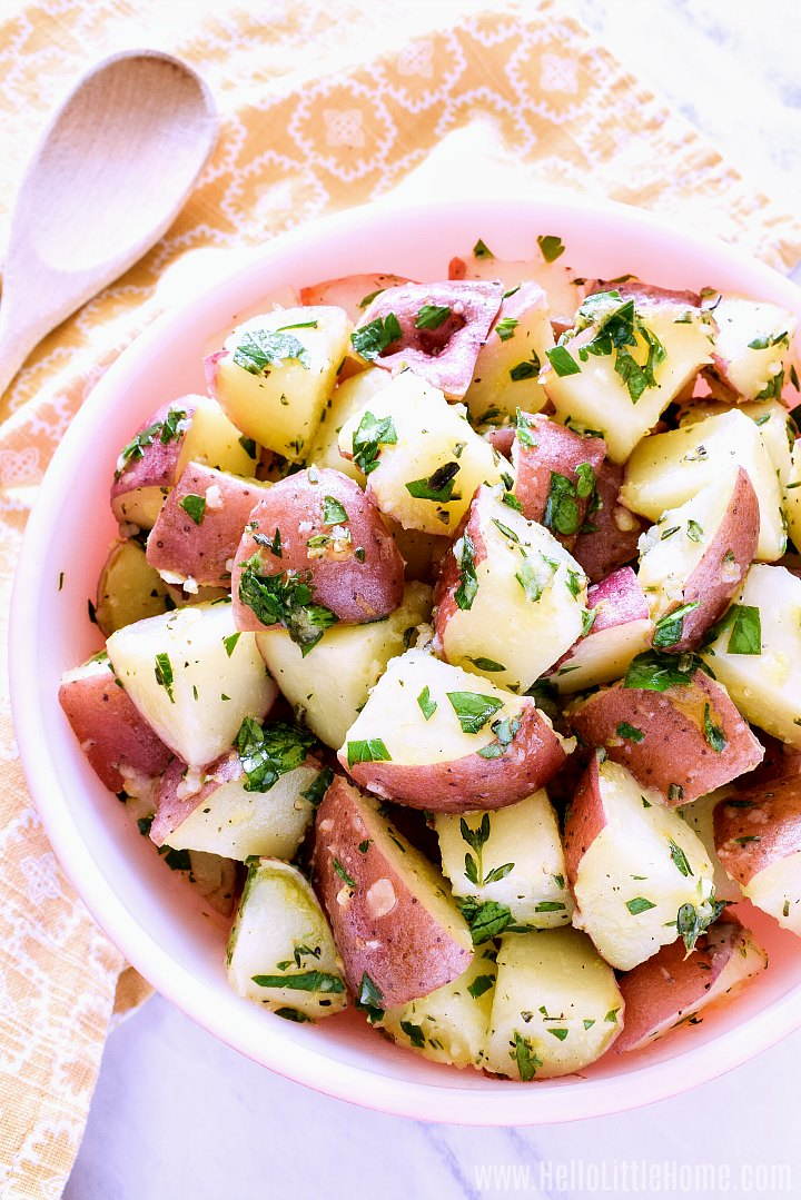 Red Potato Salad on a white counter with a yellow napkin.