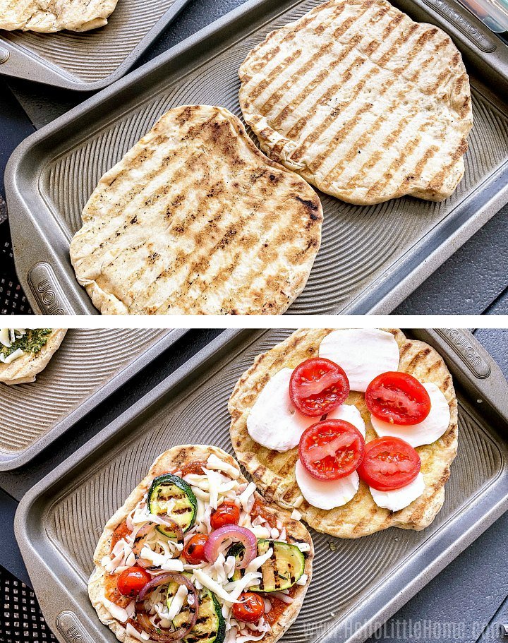 Adding toppings to grilled pizza dough.