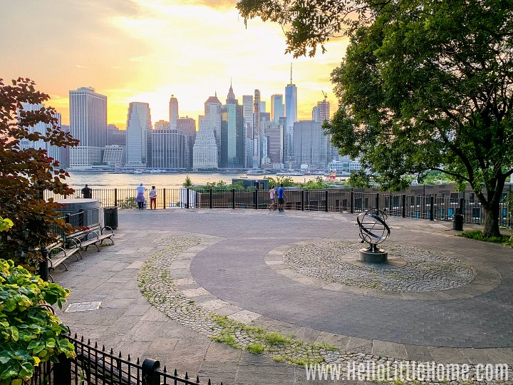 A view of the sun setting over Manhattan from the Brooklyn Heights Promenade.