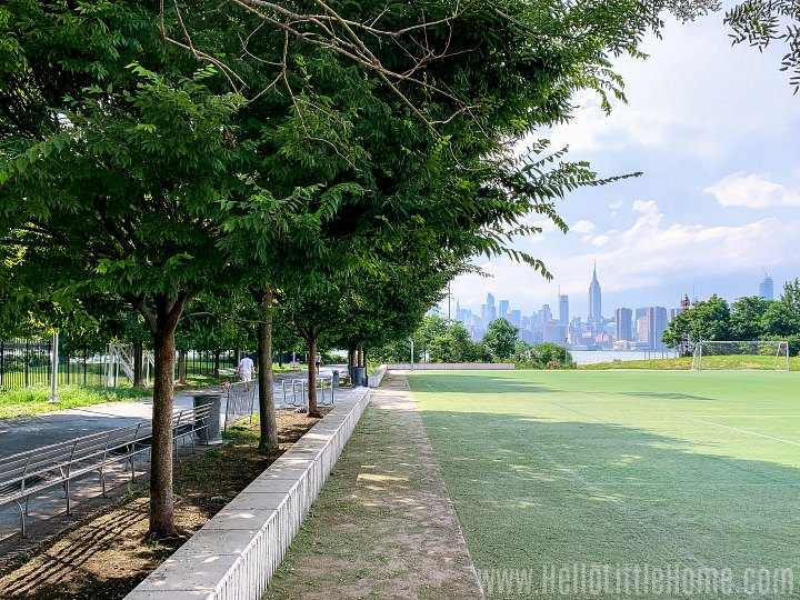 A soccer field with the Manhattan skyline in the background at Bushwick Inlet Park in Brooklyn.