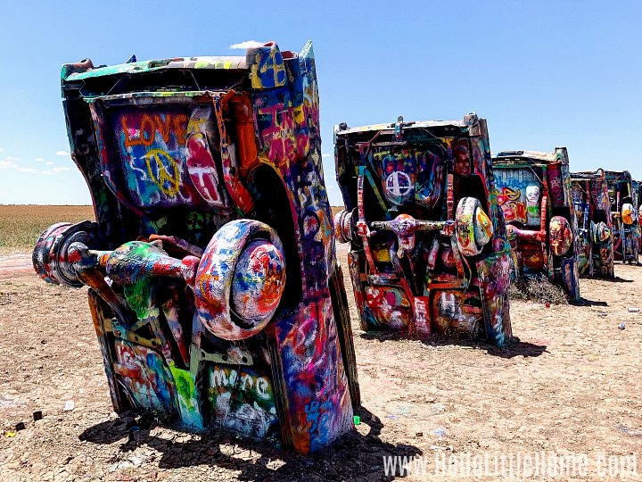 Spray painted cars at Cadillac Ranch.