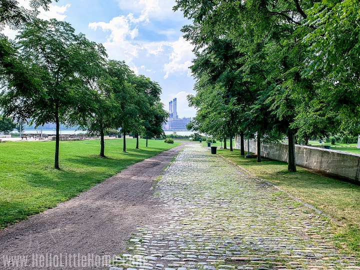 A cobblestone path leading to the water in the East River State Park in Brooklyn.
