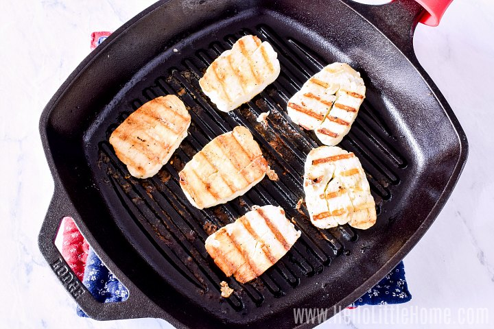Grilling halloumi cheese in a cast iron pan.