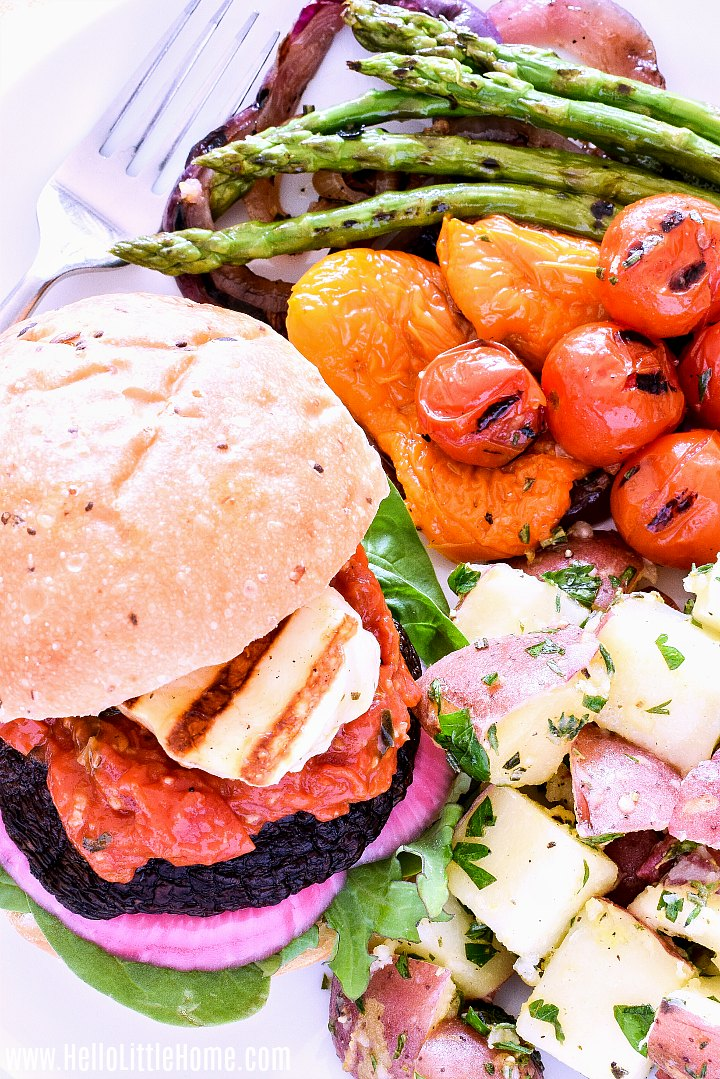 A Halloumi Burger served with potato salad and grilled vegetables.