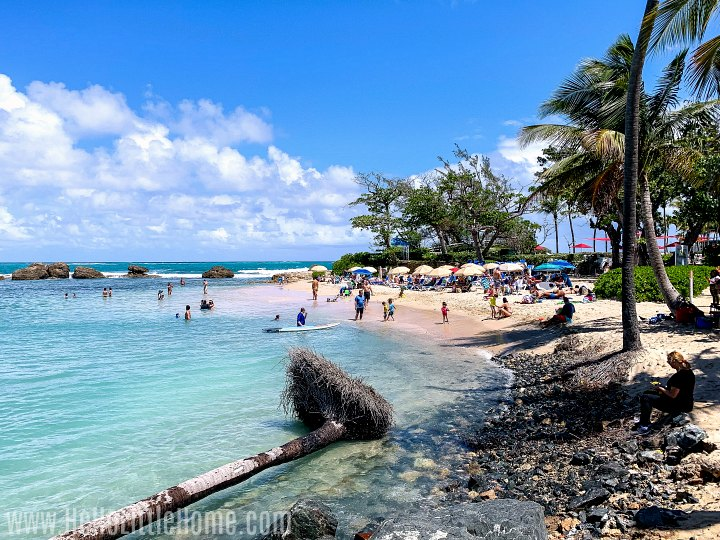A small beach in Condado with aqua blue waters.