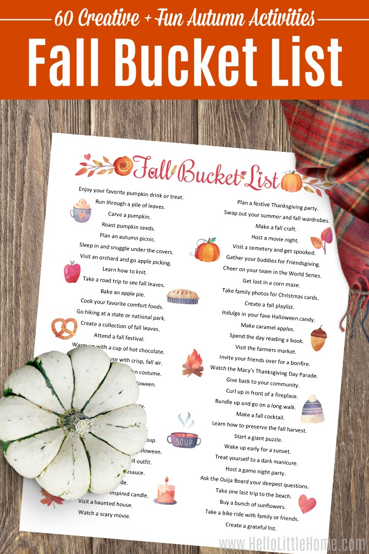 A Fall Bucket List with 60 Fall Activities on a wood table.