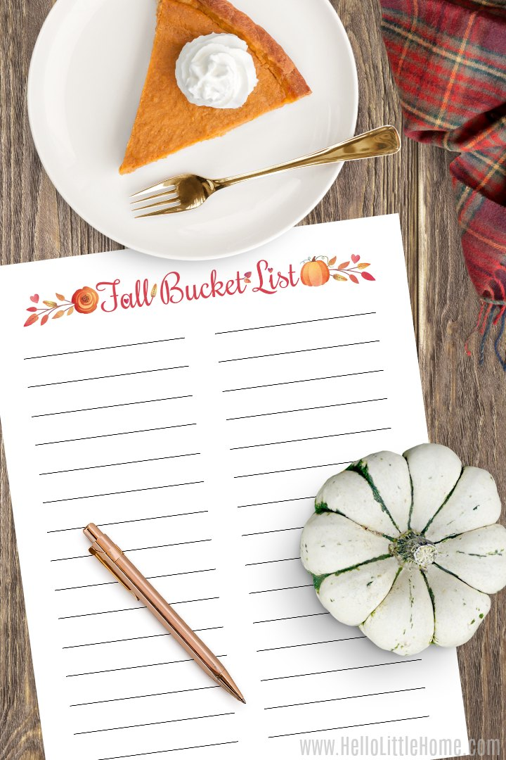 A blank fall bucket list printable on a wood table with a pumpkin and a piece of pie.