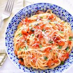 A bowl of pasta with fresh tomato sauce.