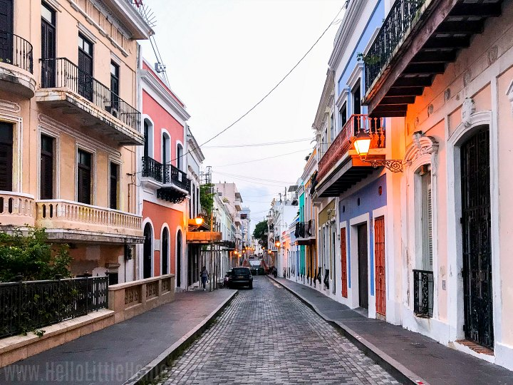 A colorful street in Old San Juan lit with lanterns in the evening.