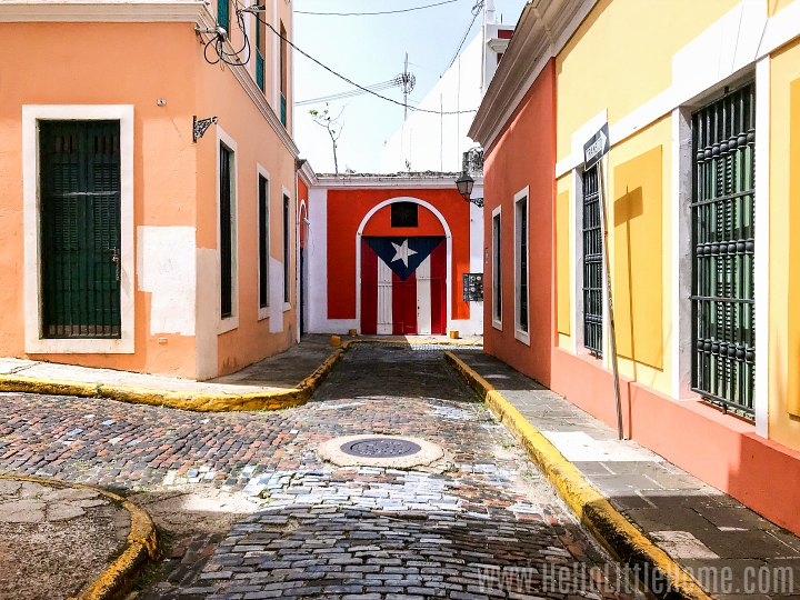 A street in Old San Juan with a Puerto Rican flag painted on a wall.