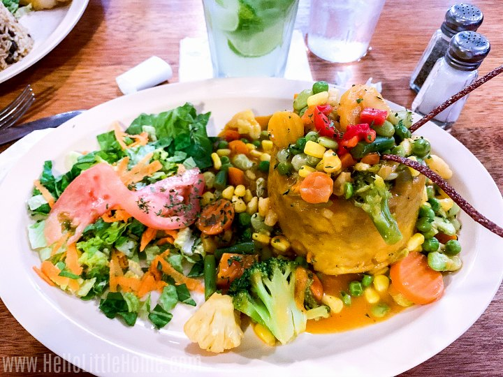 A plate topped wiht Veggie Mofongo and a salad.