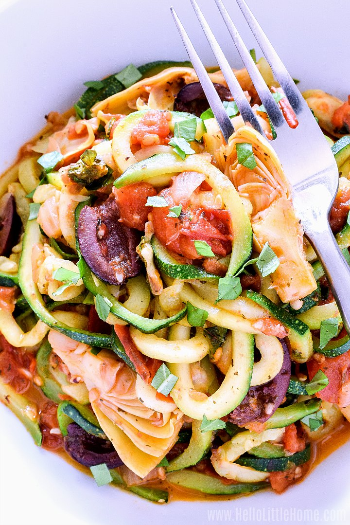 Closeup of zoodles with tomato artichoke sauce.