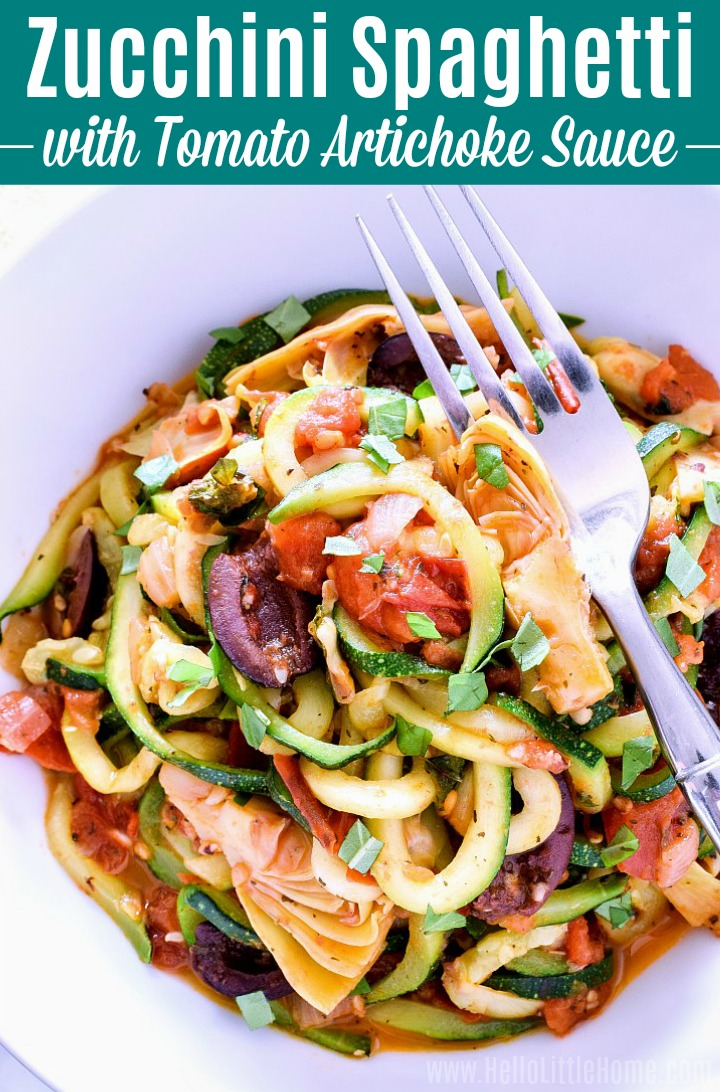 A bowl of Zucchini Spaghetti with Tomato Artichoke Sauce with a fork in it.