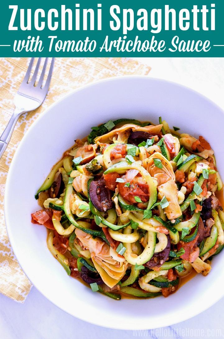 A bowl of Zucchini Spaghetti with Tomato Artichoke Sauce.