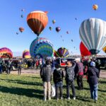 Crowds and colorful balloons at the Albuquerque Balloon Fiesta.