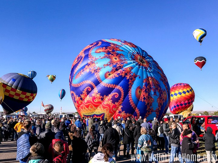Multiple hot air balloons launching in Balloon Fiesta Park.