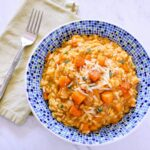 A blue bowl filled with Pumpkin Risotto.