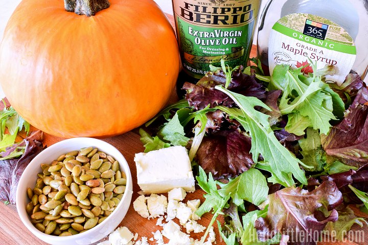 Pumpkin Salad Ingredients: salad greens, feta, pepitas, pumpkin, and more.