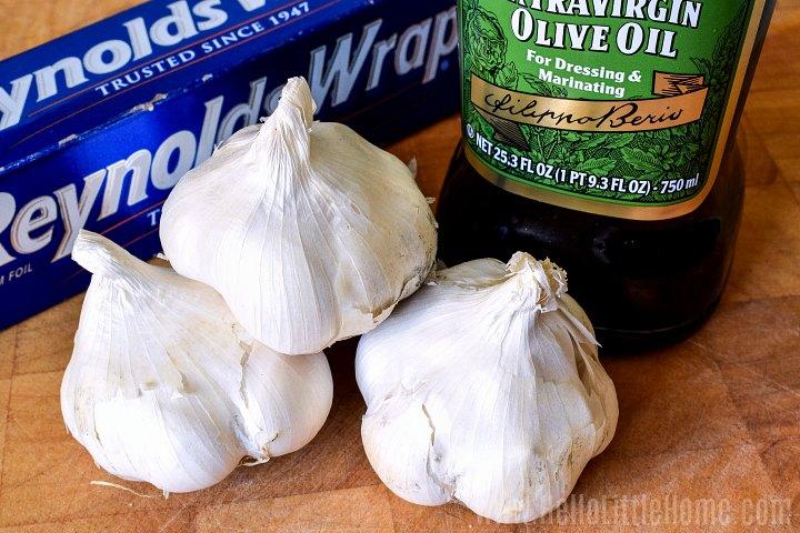 Baked garlic ingredients: garlic heads, olive oil, aluminum foil.