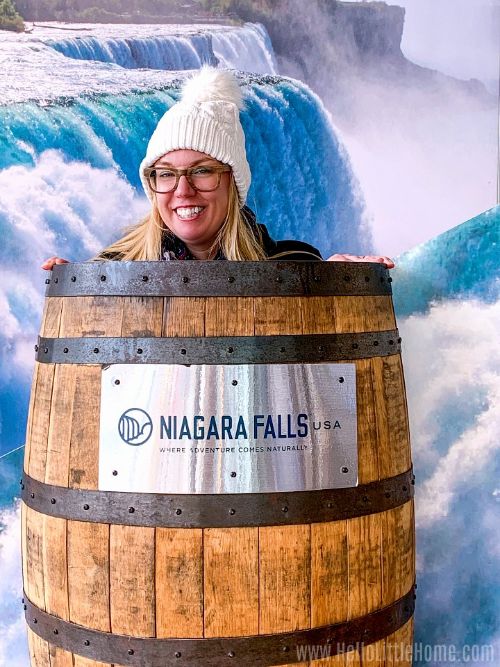 A photo booth with a bucket going over Niagara Falls at the US Visitors Center.