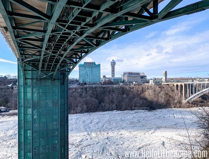 The frozen Niagara River with hotels in the distance.