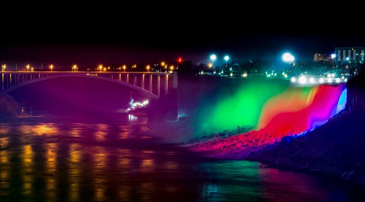 Colorful Lights on Niagara Falls at night.