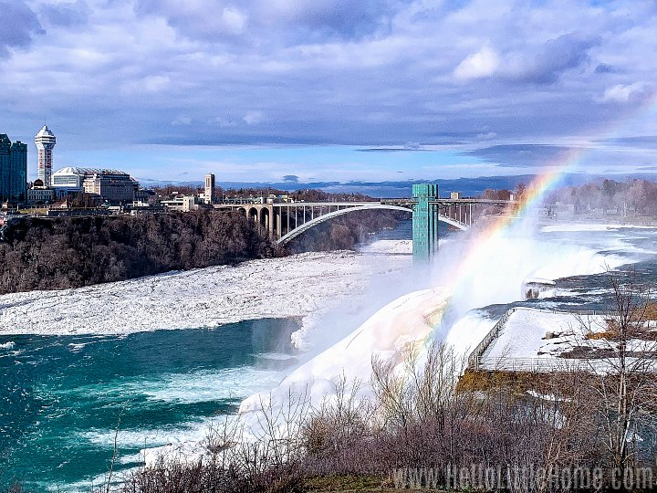 A rainbow over Bridal Veil Falls with the Rainbow Bridge in the background.