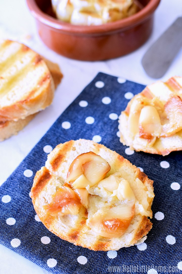 Roast Garlic cloves spread on grilled bread.