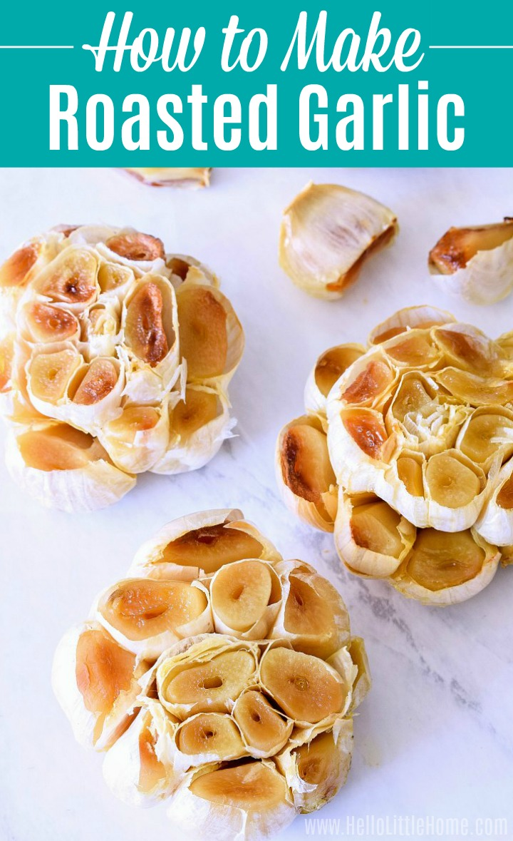 Whole heads and cloves of Roasted Garlic on a marble counter.