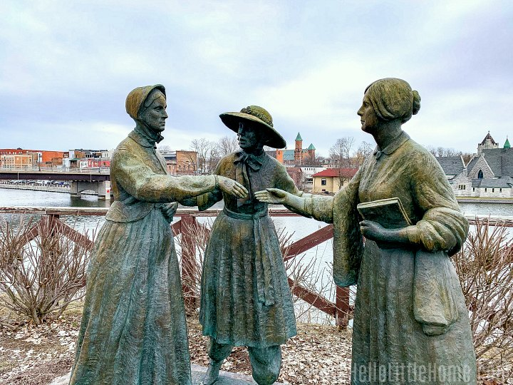 A statue of three women at the Womens Rights National Historical Park.