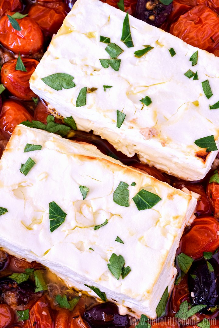 Close up of a baked feta recipe sprinkled with parsley.