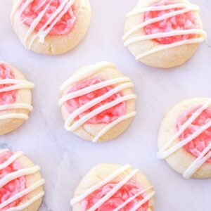 Peppermint Thumbprint Cookies on a white marble counter.