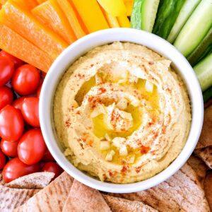 A bowl of Roasted Garlic Hummus.