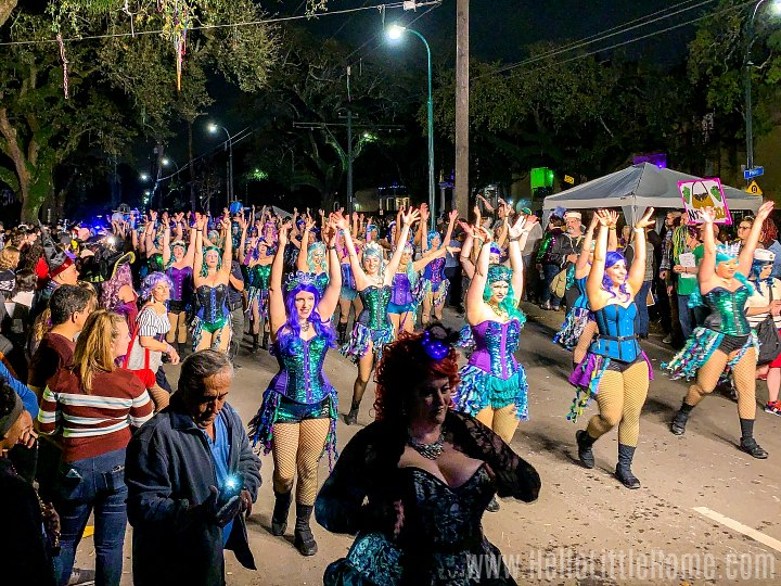 Women dancing during a Mardi Gras parade in New Orleans.