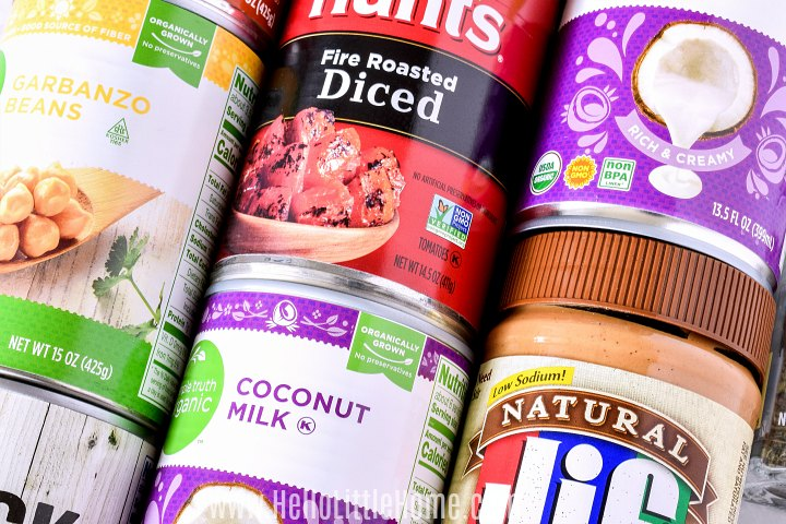 Cans of different foods arranged closely together.