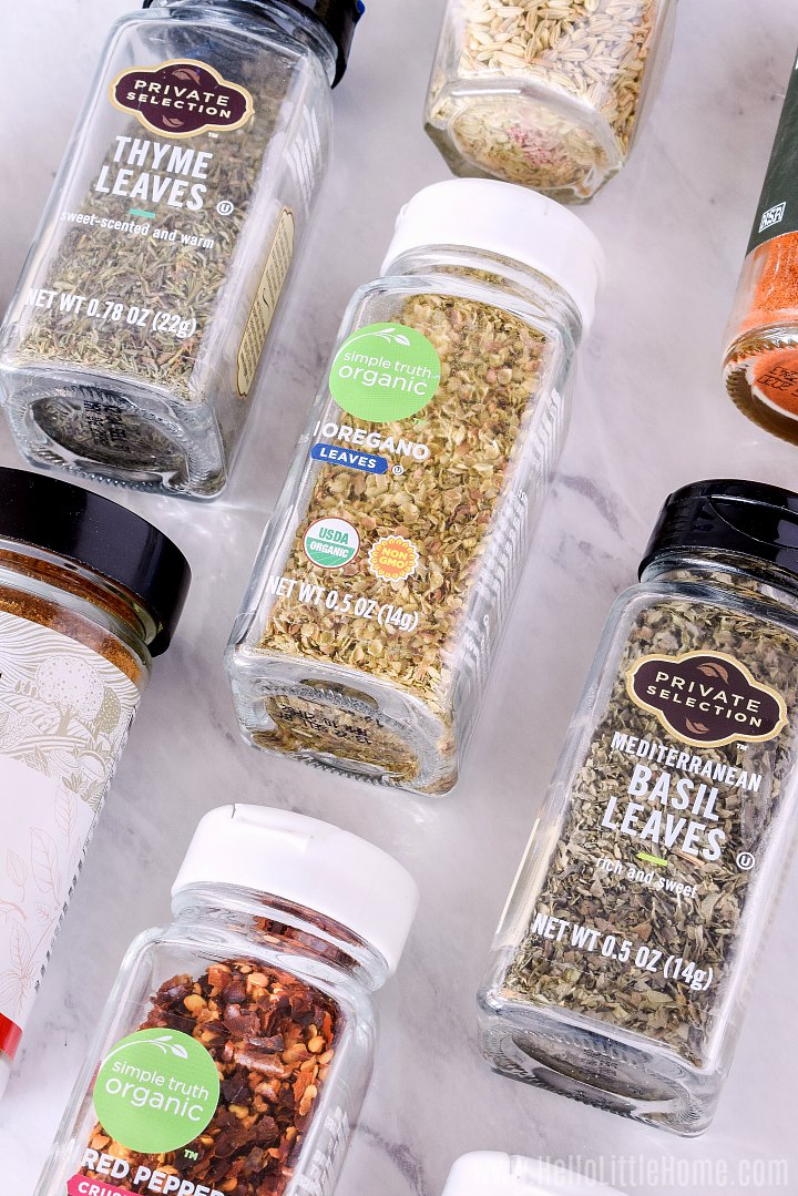 Spices laid on a marble counter.